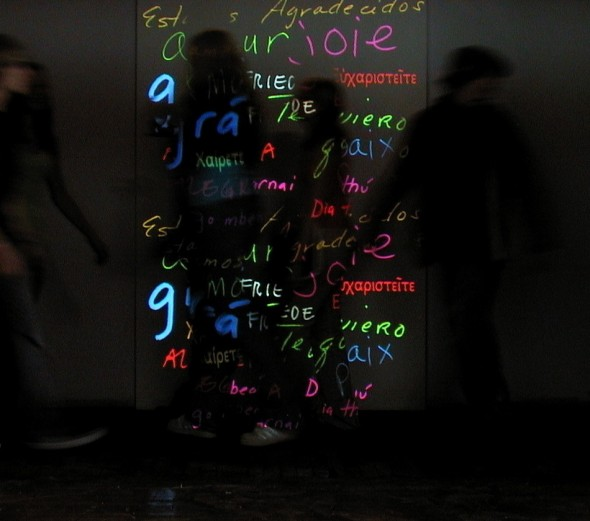 "Incantation and Intonation/ ""These Charms My Dear Charmides, are Beautiful Words"" L. Vandegrift Davala, 2005. Portal light installation, threshold mounted, beautiful words in a variety of languages. Variable size."